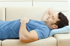 Man sleeping on couch Stock Photography