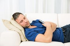 Man sleeping on couch. Portrait Of A Man Sleeping On Couch At Home Royalty Free Stock Image