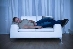 Man Sleeping On Couch. Portrait Of A Young Man Sleeping On Couch Royalty Free Stock Photography
