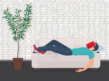 Man sleeping on the couch sofa with book covering his face. Tired student fall asleep. Man sleeping on the couch sofa with book covering his face. Tired student Royalty Free Stock Photo