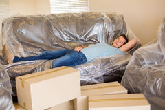 Man sleeping on couch Stock Images