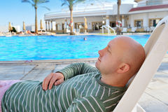 Man sleeping on a deck chair on vacation Royalty Free Stock Photo