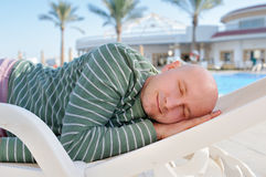 Man sleeping on a deck chair on vacation Stock Images