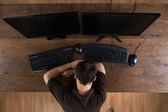 Man Sleeping At Desk With Computers Royalty Free Stock Image