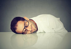 Man sleeping on a desk Royalty Free Stock Images