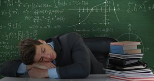 Man sleeping on desk next to books in front of moving maths calculations on chalkboard