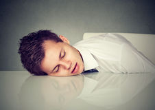 Man sleeping on a desk office table. Man sleeping on a office table Royalty Free Stock Image
