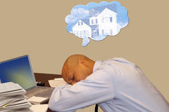 Man Sleeping and Dreaming at Work Royalty Free Stock Photography