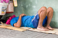 Man is sleeping on footpath Stock Images