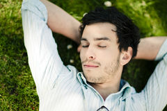 Man Sleeping on Grass Royalty Free Stock Photography