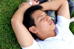Man sleeping on the grass Stock Images