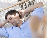 A man sleeping in a hammock Royalty Free Stock Images