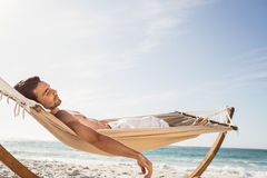 Man sleeping in hammock Stock Photo