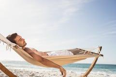 Man sleeping in hammock Stock Photo