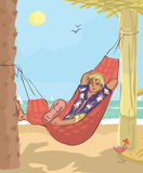 Man sleeping in hammock at beach Stock Images