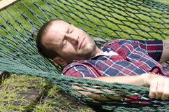 Man sleeping in hammock. Man sleeping in hammock with eyes closed Stock Photography