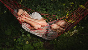 Man sleeping in hammock. Stock Photography
