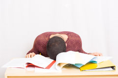 Man sleeping on his books Stock Images
