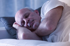 Man sleeping on his couch Stock Photography