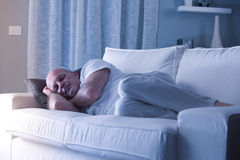 Man sleeping on his couch Royalty Free Stock Photography