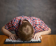 Man sleeping on his keyboard. Royalty Free Stock Image
