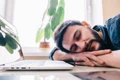 Man sleeping with his laptop Stock Photo