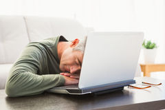 Man sleeping on his laptop Stock Image