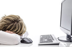 Man sleeping at his office desk Stock Photos