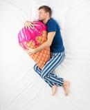 Man sleeping with ice cream toy Stock Photo