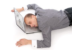 Man sleeping on the laptop Royalty Free Stock Images