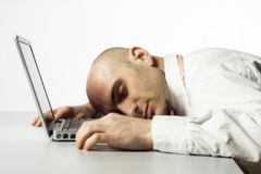 Man sleeping on laptop computer Royalty Free Stock Images