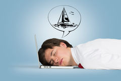 Man sleeping on the laptop and dreaming Stock Image