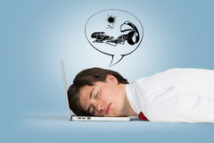 Man sleeping. On the laptop and dreaming about vacation Stock Images