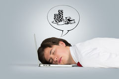 Man sleeping on the laptop Royalty Free Stock Photo