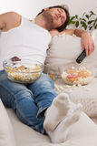 Man sleeping in a mess of food Royalty Free Stock Photography