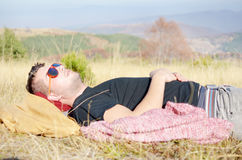Man sleeping in the mountain Royalty Free Stock Photography