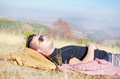 Man sleeping in the mountain Stock Photography
