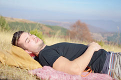 Man sleeping in the mountain Stock Photo