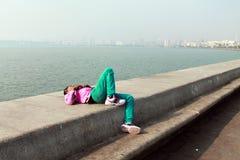 Man sleeping in Mumbai. On the bank of Arabian Sea Stock Image