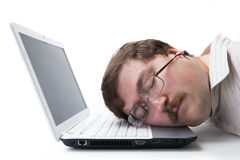 Man sleeping on a notebook keyboard at the workpla Stock Photography