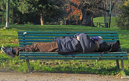 Man is sleeping in park of Milan Royalty Free Stock Images