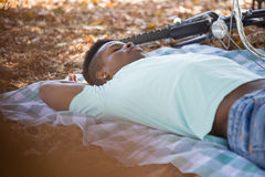 Man sleeping on a picnic blanket Royalty Free Stock Images