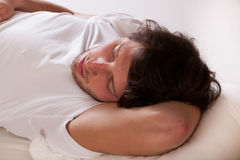 Man sleeping on a pillow Royalty Free Stock Image