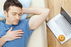 Man sleeping on sofa royalty free stock image