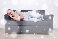 Man sleeping on sofa at home. Young man sleeping on sofa at home Stock Photo