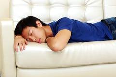 man sleeping on the sofa Royalty Free Stock Photography
