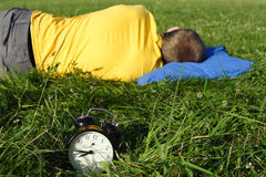 Man sleeping on summer lawn Stock Photography
