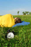 Man sleeping on summer lawn Stock Photos