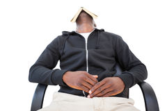 Man sleeping in swivel chair with book over face Royalty Free Stock Images