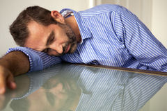 Man sleeping at table Stock Image